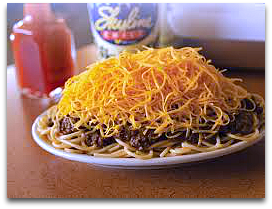spaghetti topped with skyline cincinnati chili and shredded cheese