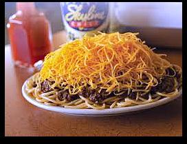 spaghetti topped with skyline cincinnati chili and shredded cheese