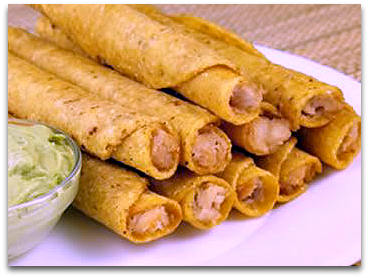 Chicken Taquitos on a plate with guacamole sauce