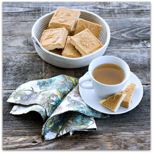 Dish of shortbread with cup of tea & napking