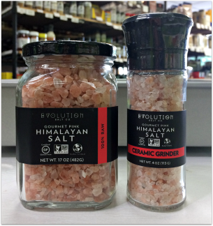 A jar and a ceramic grinder of Evolution brand gourmet pink Himalayan salt.