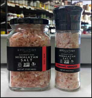 A jar and a ceramic grinder of Evolution brand gourmet pink Himalayan salt.