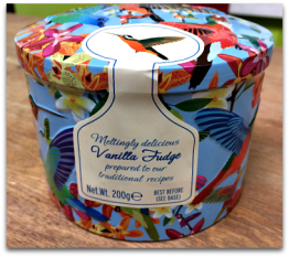 Gardiner's Vanilla Fudge Tin brightly colored with hummingbirds