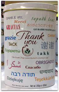 "A white tin with the word ""Thank You"" in many languages"