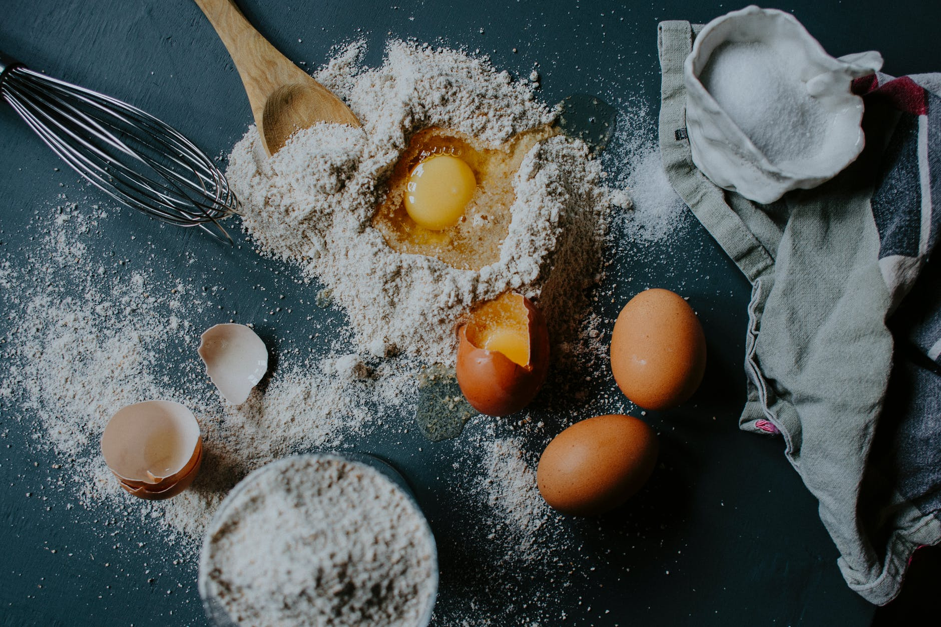 ingredients for pasta dough preparation scattered on table